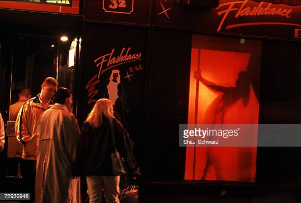 Men stand outside a strip club in Budapest Hungary