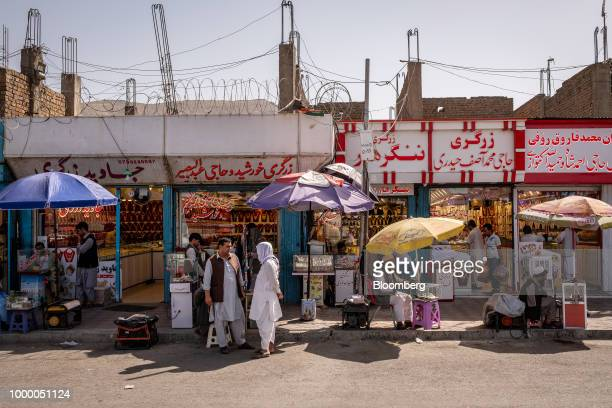 Men stand outside jewelry stores in Kabul Afghanistan on Thursday July 12 2018 US President Donald last year said 16000 US troops would remain in...