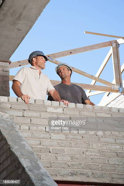 Men standing at new construction site