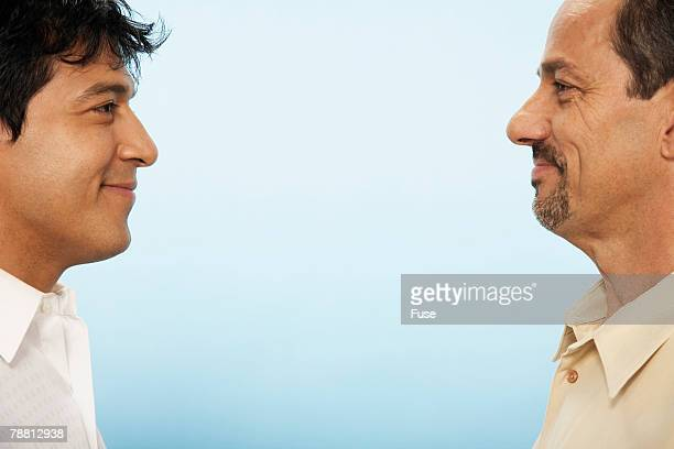 Men Standing Face to Face Smiling