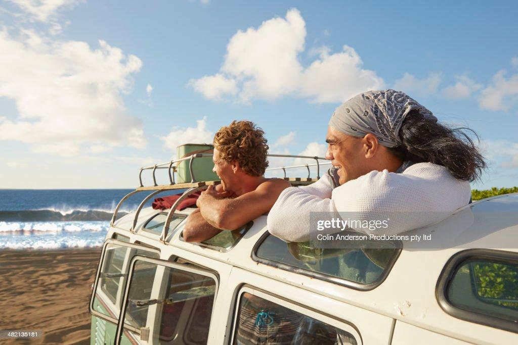 Men standing in van outdoors : Stock Photo