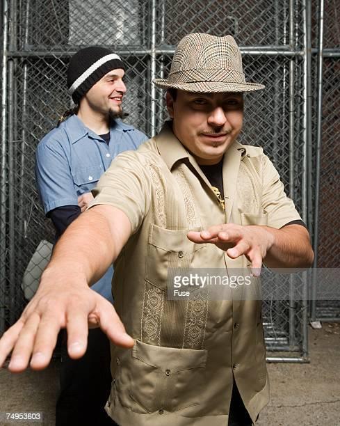 men standing near chain-link fence - moderne rockmusik stock-fotos und bilder