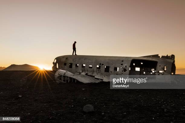Men standing on Airplane Wreck - Solheimasandur Iceland