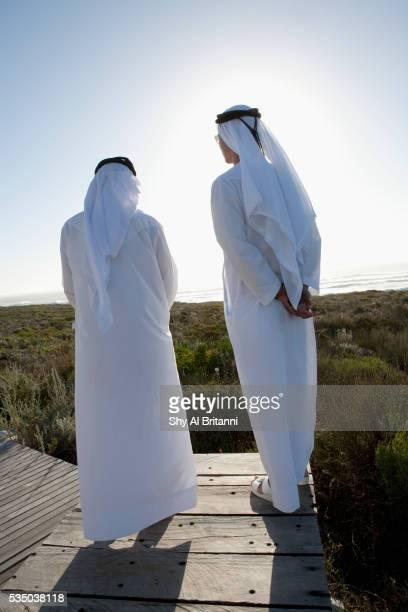 Men standing on boardwalk