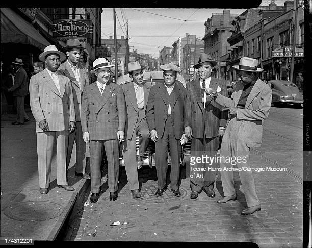 Men standing on Wylie Avenue including Jerry Sumpter Alphonse 'Fons' Moore Leon 'Pigmeat' Clark Leroy Mason Billy Snyder and Herman Ross Hill...