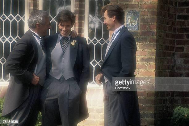 Men standing outdoors at wedding