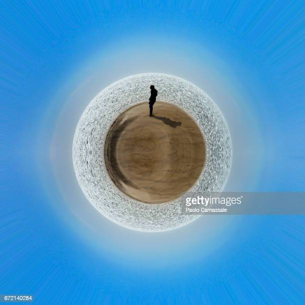 men standing over desert planet earth - digital distortion stock photos and pictures