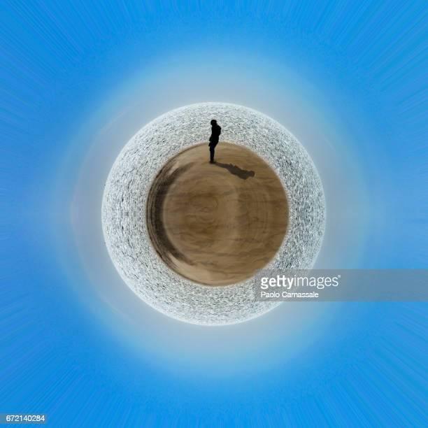 Men standing over desert planet earth