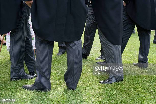 men standing - tail coat stock pictures, royalty-free photos & images