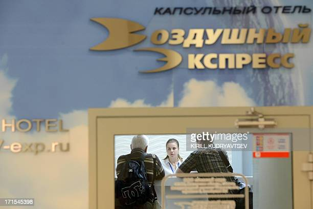 A men stands in the Capsule Hotel 'Air Express' inside Moscow's Sheremetyevo terminal F in Moscow on June 26 where US intelligence leaker Edward...
