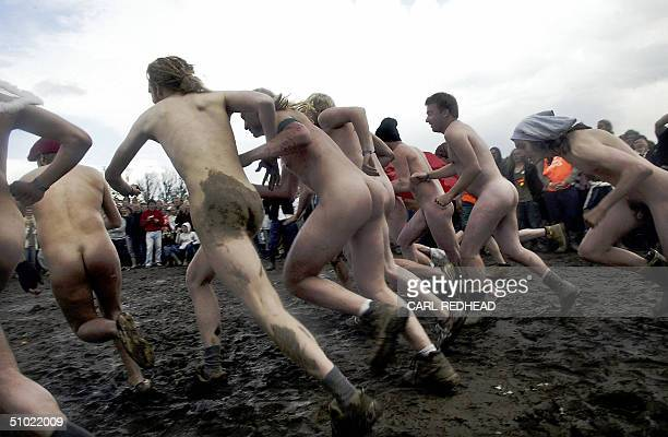 13 men start the traditional Nude Race at the Roskilde Festival 03 July 2004 The fastest of the runners were awarded Tshirts tents and skin care...