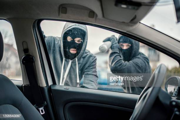 men stealing a car - looting stock pictures, royalty-free photos & images