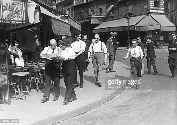 Men strolling in a the street during the heatwave in 1928 in Paris France