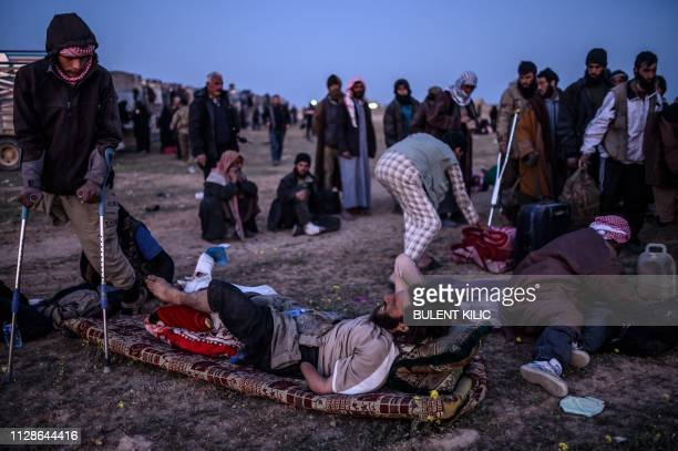 Men suspected of belonging to the Islamic State group wait to be searched by members of the Kurdishled Syrian Democratic Forces just after leaving...