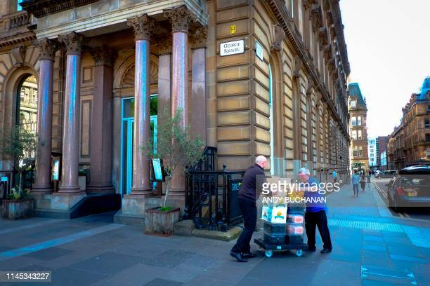 Men take away stock from a closeddown Jamie's Italian restaurant in Glasgow on May 21 2019 British celebrity TV chef Jamie Oliver said Tuesday that...