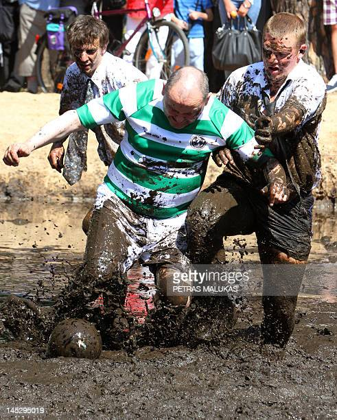Men take part in a mud football match organized by a local radio station to mark the National Men Day in Druskininkai resort on May 25 2012 AFP PHOTO...