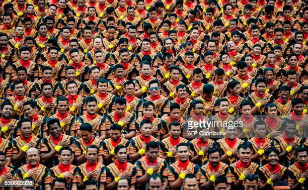 Men take part in a rehearsal of a mass traditional Saman dance performance in the Gayo Lues highland district in Aceh on Indonesia's Sumatra island...