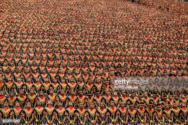 TOPSHOT Men take part in a rehearsal of a mass traditional Saman dance performance in the Gayo Lues highland district in Aceh on Indonesia's Sumatra...