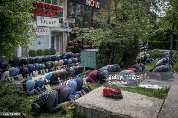 Men take part in Friday prayer in the street outside a mosque on May 3, 2019 in Pristina, Kosovo. A recent EU-backed summit failed to restart...