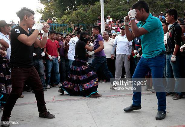 Men take part in the traditional Xochimilcas fight to defend their women against the Aztecs in the Mexican municipality of Zitlala in Guerrero...