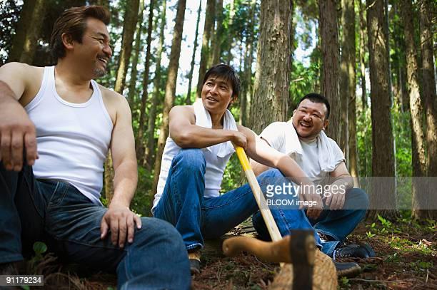 Men taking rest, smiling