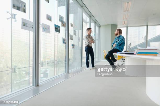 men talking in design office meeting room - wide angle stock pictures, royalty-free photos & images