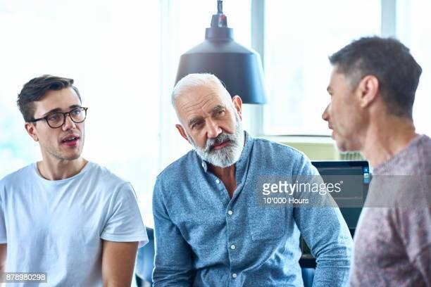 Men talking in modern office