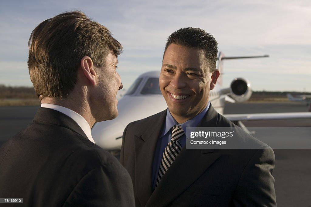 Men talking near airplane. : Stockfoto