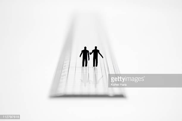 2 men talking on a ruler