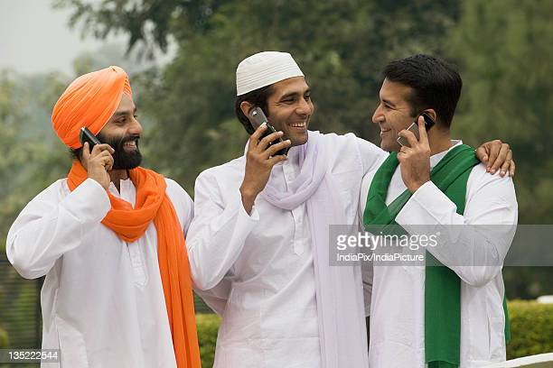 Men talking on mobile phones