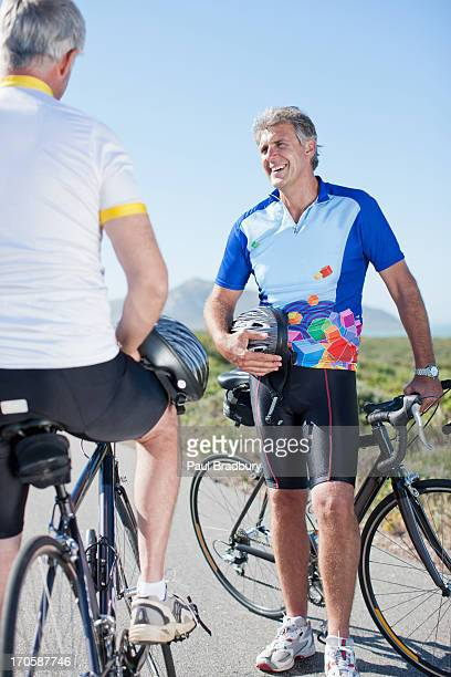 Men talking with bicycles in remote area