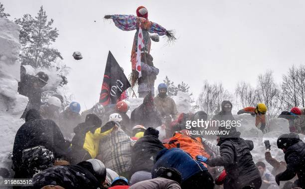 TOPSHOT Men throw snowballs in a traditional fight during the festivities of Shrovetide or Maslenitsa close to the village of Electrougli outside...