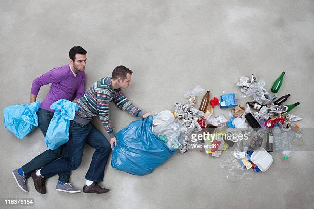 Men throwing garbage