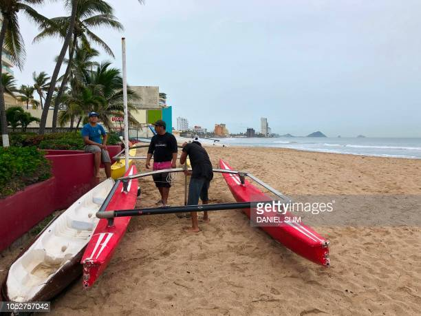 Men tie a kayak at the beach in Mazatlan Sinaloa state Mexico on October 22 before the arrival of Hurricane Willa Hurricane Willa upgraded to maximum...