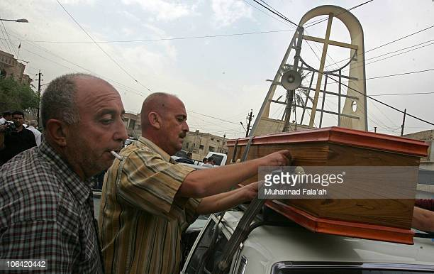 Men tie up a coffin of a victim from the attack on the Syrian Catholic church of Our Lady of Deliverance on November 1 2010 in Baghdad Iraq Gunmen...