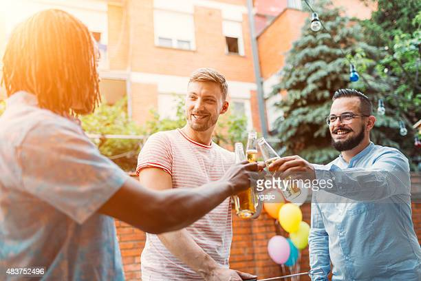 Men Toasting At Barbecue Party.