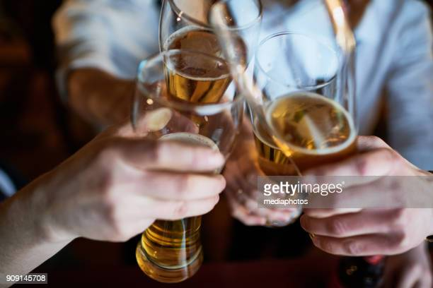 Men toasting beer glasses