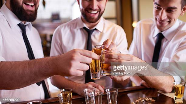 Men toasting in the bar