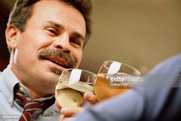 men toasting - vcg stock pictures, royalty-free photos & images