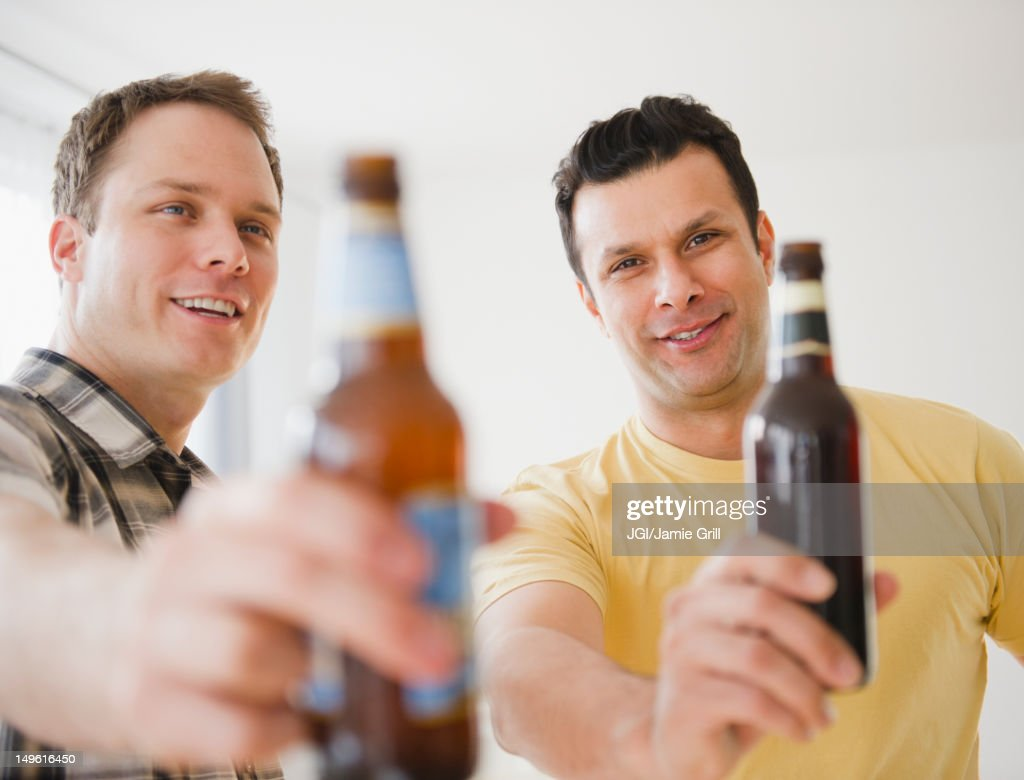 Men toasting together with beer : Stock Photo