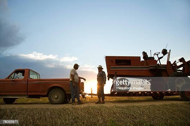 men towing tractor - thinkstock foto e immagini stock