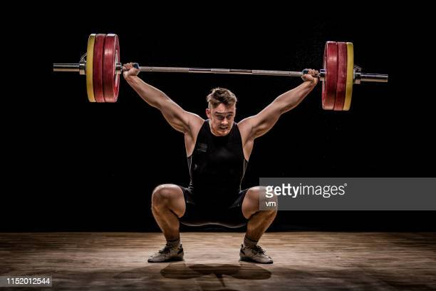 men training with barbells - weight training stock pictures, royalty-free photos & images