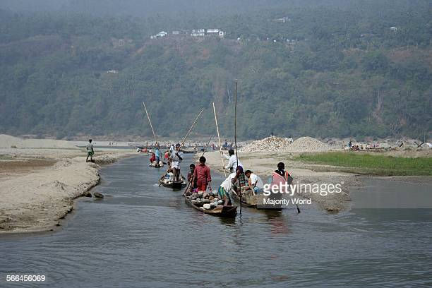 Men transport stones collected from the bed of the Dauki river by boat The river in its downward journey from the Himalayas carries an abundance of...