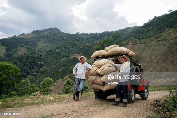 men transporting sacks of coffee in a car - colombia stock pictures, royalty-free photos & images