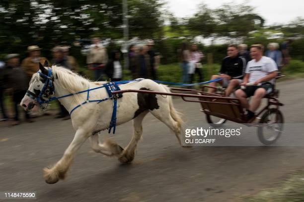 Men travel by horse and carriage along 'Flashing Lane' on the second day of the annual Appleby Horse Fair, in the town of Appleby-in-Westmorland,...