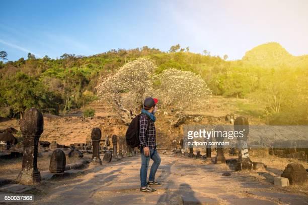 Men traveling in Vat Phou Champasak Laos.