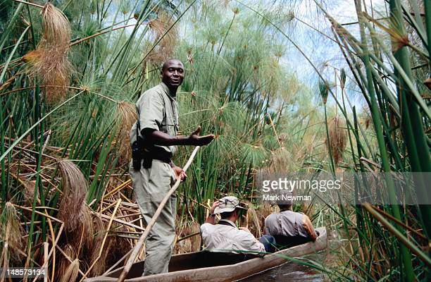 Men travelling by traditional mokoro (dugout canoe).