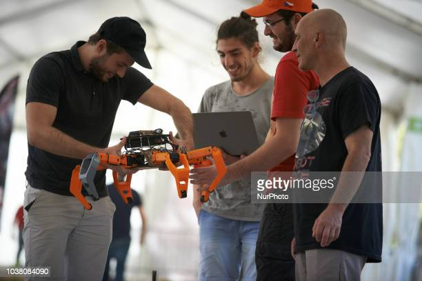 Men try to understand why their robot failed A robots race took place in Toulouse Machines are either cars or walking robots They were supposed to...