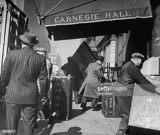 Men unloading B.S.O. Trunks from a truck into Carnegie Hall.