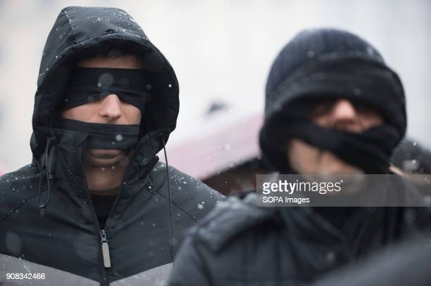 Men use black bands over their eyes and mouths during a silent assembly named Stolen Justice in Krakow Stolen Justice happening intend to express...